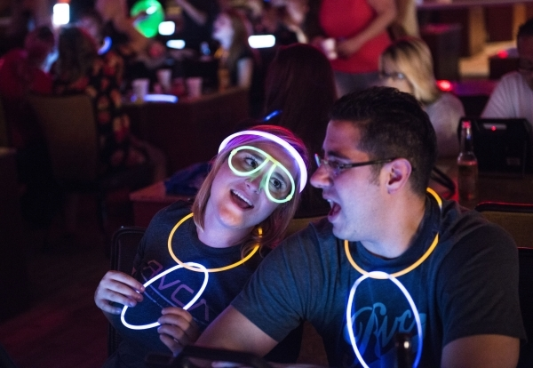 Deanna Littlefield and Justin Prince sing during Rocket Bingo at Red Rock Resort in Las Vegas on Thursday, Aug. 27, 2015. Rocket Bingo features a DJ, dancing, shots, and nightclub atmosphere. Jaco ...