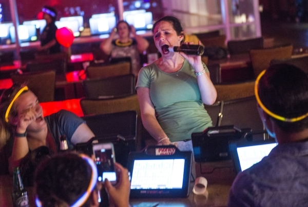 Devon Butts sings during Rocket Bingo at Red Rock Resort in Las Vegas on Thursday, Aug. 27, 2015. Rocket Bingo features a DJ, dancing, shots, and nightclub atmosphere. Jacob Kepler/Las Vegas Revie ...