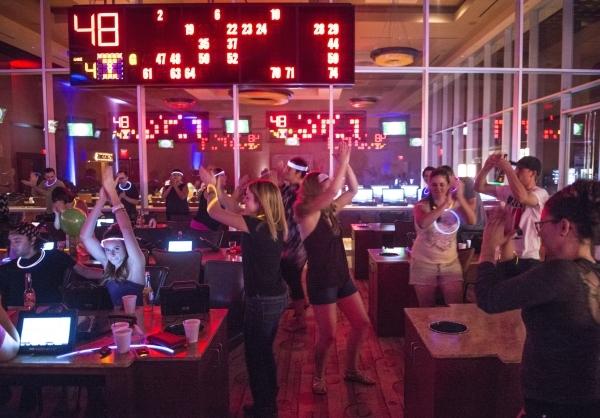 Attendees dance during Rocket Bingo at Red Rock Resort in Las Vegas on Thursday, Aug. 27, 2015. Rocket Bingo features a DJ, dancing, shots, and nightclub atmosphere. Jacob Kepler/Las Vegas Review- ...