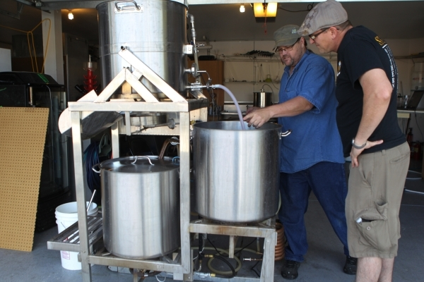 Local home beer brewer Jimmy Doyle, left, works on making a red India pale ale beer at his home with his friend Clyde Lipp on Sunday, Sept. 5, 2015 in Las Vegas. ERIK VERDUZCO/LAS VEGAS REVIEW-JOU ...