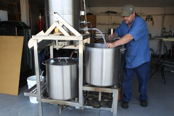 Local home beer brewer Jimmy Doyle works on making a red India pale ale beer at his home in Las Vegas Sunday, Sept. 5, 2015. ERIK VERDUZCO/LAS VEGAS REVIEW-JOURNAL Follow him @Erik_Verduzco