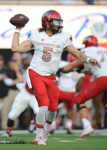 UNLV Rebels quarterback Blake Decker (5) passes on the run against the Northern Illinois Huskiesin the first half of their NCAA Football game at Huskie Stadium in DeKalb, Ill.  Saterday, Sept. 05, ...