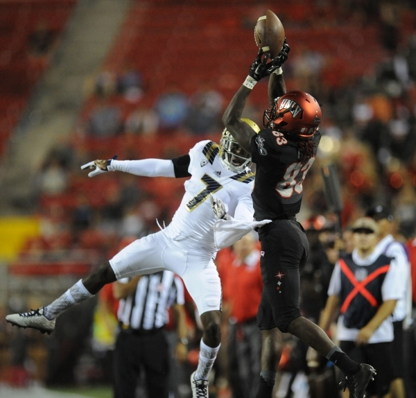UNLV Rebels wide receiver Devonte Boyd (83) catches a pass out of bounds in front of UCLA Bruins defensive back John Johnson (7) in the fourth quarter at Sam Boyd Stadium Saturday, Sept. 12 2015.  ...