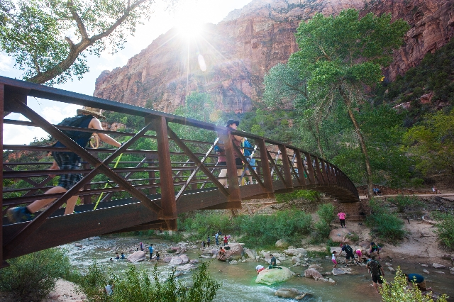People cross a bridge over the Virgin River to the Emerald Pools trail at Zion National Park in Utah on Sunday, Sept. 6, 2015. Chase Stevens/Las Vegas Review-Journal Follow @csstevensphoto