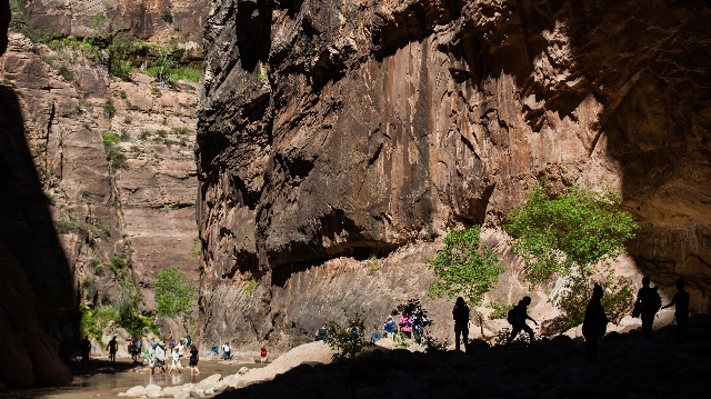 People walk along the Virgin River while hiking the Narrows at Zion National Park in Utah on Monday, Sept. 7, 2015. Chase Stevens/Las Vegas Review-Journal Follow @csstevensphoto