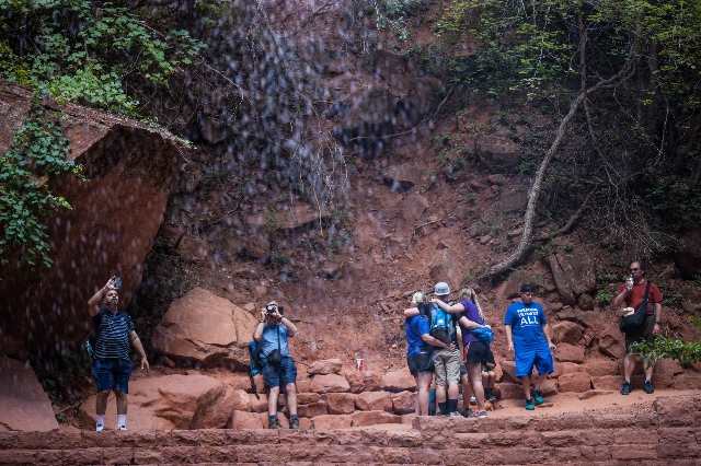 People take photos around a waterfall at the Lower Emerald Pool at Zion National Park in Utah on Sunday, Sept. 6, 2015. Chase Stevens/Las Vegas Review-Journal Follow @csstevensphoto