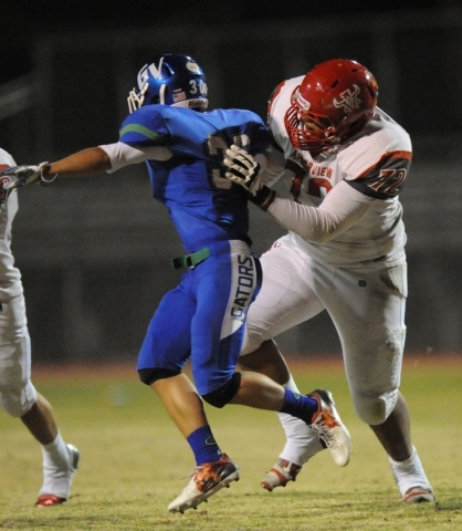 Arbor View linebacker Keenen King (72) blocks Green Valley cornerback Avery Fleharty in the fourth quarter of their high school football game at Green Valley High School in Henderson Friday, Sept. ...