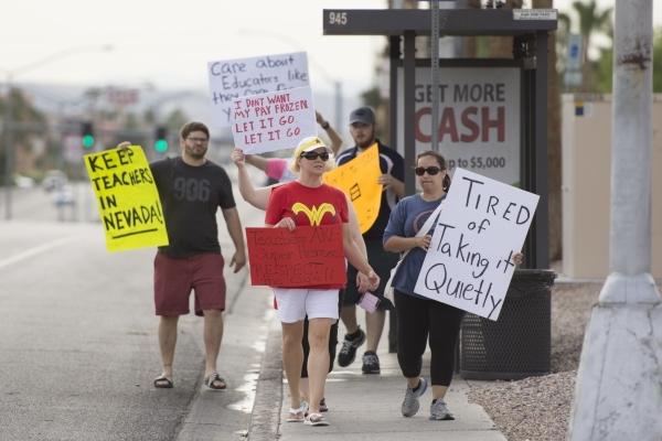 Clark County School District teachers picket outside of the district's Edward Greer Education Center in Las Vegas on Thursday, July 2, 2015. (Jason Ogulnik/Las Vegas Review-Journal)