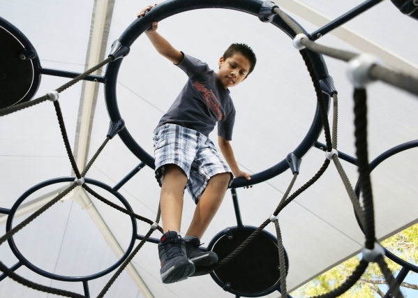 Ruben Herrera, 10, climbs on play equipment at the newly renovated Joe Kneip Park Thursday, Sept. 17, 2015, in North Las Vegas. The park was selected by the National Recreation and Park Associatio ...