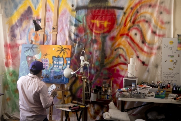 Pete Castro paints inside his home studio in northwest Las Vegas on Saturday, Sept. 19, 2015. Castro is self-taught and has gained enough notoriety to secure an exhibition in New York City later t ...