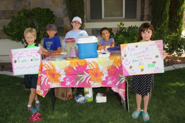 Summerlin children, from left, Nate, Ben, Aislin Deeney, Francesca Gregoryon and Ches Deeney, are seen Sept. 7, 2015, in a neighborhood near Summerlin Hospital, where they hosted a lemonade stand  ...