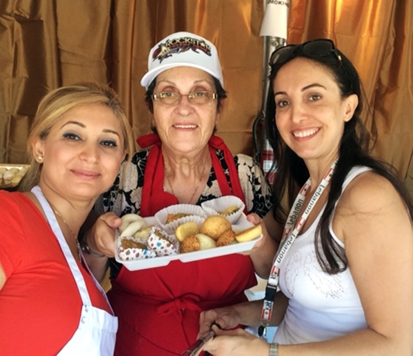 From left, Josie Smythe, Mimi Karam and Marlene Hayek display a plate of pastries available at last year's Lebanese American Festival at St. Sharbel Maronite Catholic Church, 10325 Rancho De ...