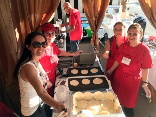 Members of St. Sharbel Maronite Catholic Church, 10325 Rancho Destino Road, help prepare katayef at the church's Lebanese American Festival last year. Katayef is a small pancake cooked on on ...