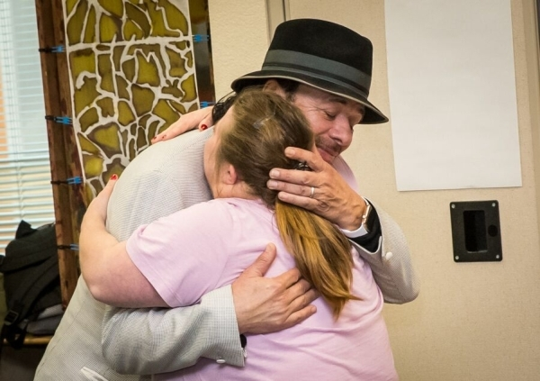 Carlos Santana hugs an Opportunity Village client during a visit to the nonprofit's Ralph and Betty Engelstad Campus Sept. 15. (Special to View)