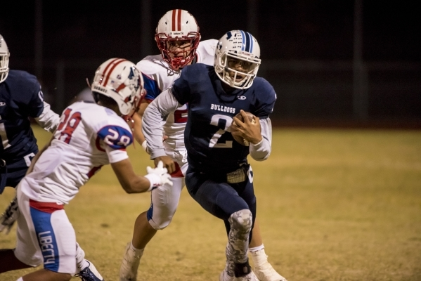 Centennial Bulldogs quarterback Jamaal Evans (2) runs with the ball against the Liberty Patriots at Carol Leavitt Stadium at Centennial High School in Las Vegas on Friday, Sept. 18, 2015. (Joshua  ...