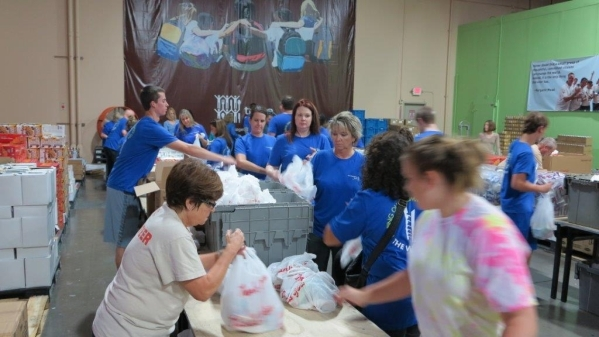 City National colleagues fill bags of food to be distributed to at-risk students in the Clark County School District. (Special to View)