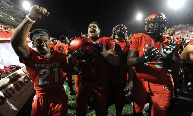 UNLV Rebels players celebrate their 80-8 victory over the Idaho State Bengals at Sam Boyd Stadium in Henderson Saturday, Sept. 26, 2015. (Josh Holmberg/Las Vegas Review-Journal)