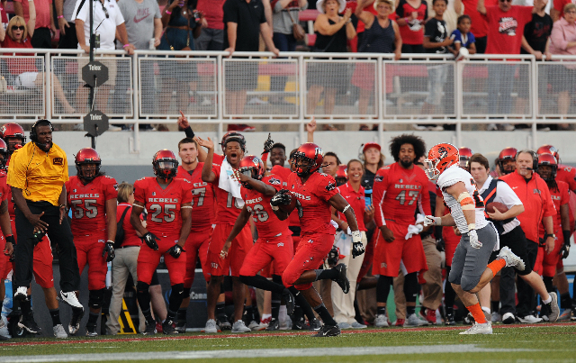 UNLV Rebels wide receiver Aaron Criswell (9) returns the opening kick-off 58 yards as the UNLV bench reacts first half of their NCAA Football game against Idaho State at Sam Boyd Stadium in Hender ...