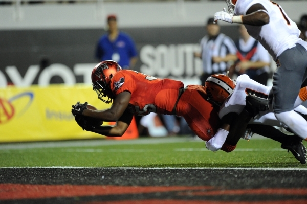 UNLV Rebels running back Xzaviar Campbell (35) scores a touchdown in the first half at Sam Boyd Stadium on Saturday, Sept. 26, 2015. UNLV defeated Idaho State 80-8, setting a new school record for ...