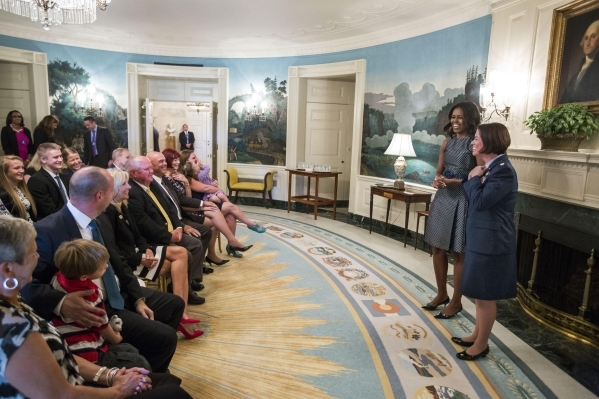 First Lady Michelle Obama participates in a promotion ceremony for Col. Nicole Malachowski in the Diplomatic Reception Room of the White House, Sept. 16, 2015. (Official White House Photo by Chuck ...