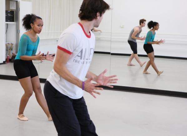 Choreographer Ariel Triunfo, left, rehearses with dancers Sergio Alvarez, center, and Morgan Stillman, reflected at right, for the annual A Choreographers' Showcase at Nevada Ballet Theatre  ...