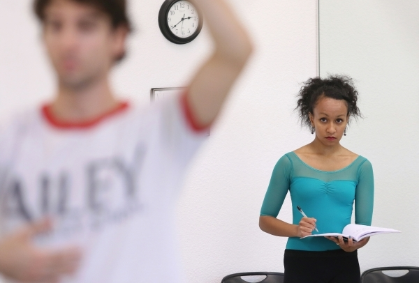 Choreographer Ariel Triunfo, right, watches dancers perform during a rehearsal of her piece for the annual A Choreographers' Showcase at Nevada Ballet Theatre Friday, Sept. 25, 2015, in Las  ...