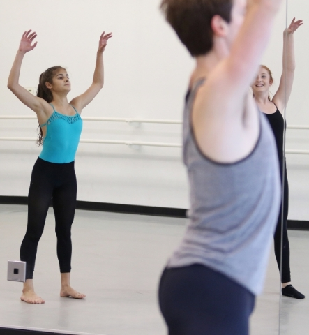 Dancers Mayra Munoz, 15, from left, Morgan Stillman, and Erin Waldeck, 14, perform during a rehearsal of Ariel Triunfo's piece for the annual A Choreographers' Showcase at Nevada Balle ...