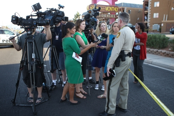 Las Vegas police LT. Dan McGrath speaks to the media on a body found inside a water vault in front of The Suites apartments near the intersection of S. Nellis Boulevard and E. Flamingo Road in Las ...