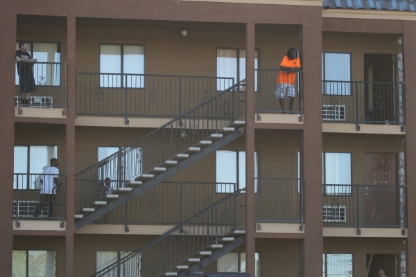 Residents at The Suites watch as investigators retrieve a body from a water vault near the intersection of S. Nellis Boulevard and E. Flamingo Road in Las Vegas Tuesday, Sept. 22, 2015. ERIK VERDU ...