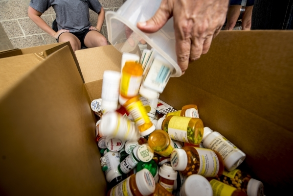 Prescription drugs are dumped into a box at the Las Vegas Metro Police Department Northwest Command Center in Las Vegas on Saturday, Sept. 26, 2015. The public was invited to dispose of unwanted m ...