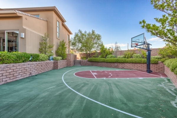 The home has a basketball court in the yard. COURTESY PHOTO
