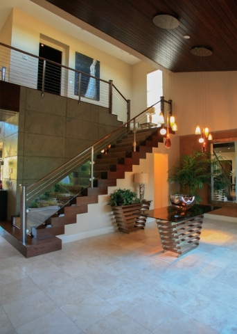 The staircase connects the home's two levels. ELKE COTE/REAL ESTATE MILLIONS