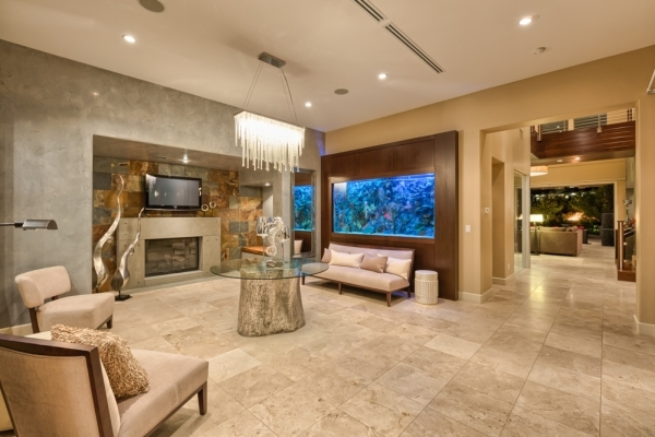 The living room has a large aquarium as a centerpiece. COURTESY PHOTO