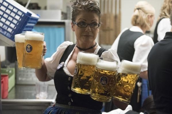 Server Juline Walsh brings beer to patrons at Hofbrauhaus Las Vegas in Las Vegas Friday, Sept. 25, 2015. Jason Ogulnik/Las Vegas Review-Journal