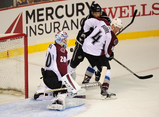 Colorado Avalanche goaltender Reto Berra makes a save as Avalanche  defenseman Tyson Barrie (4)