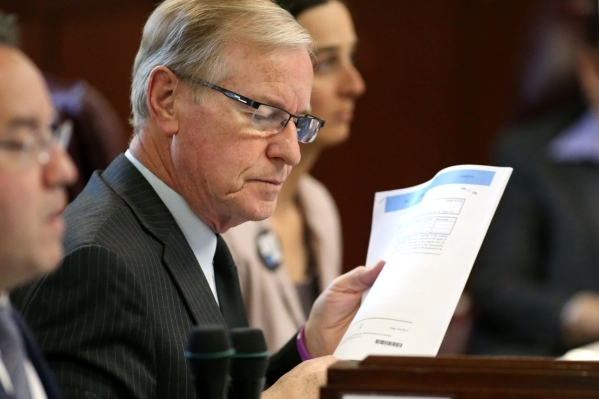 Nevada Sen. David Parks, D-Las Vegas, works on the Senate floor at the Legislative Building in Carson City, Nev., on Thursday, April 9, 2015. Parks confirmed Thursday his bill that would allow ter ...