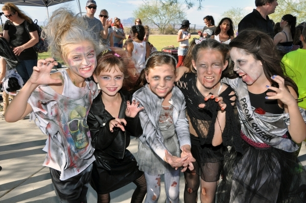 Youths participate in the city of Henderson's Zombie Run 5K last year. The event is scheduled again this year at 6 p.m. Oct. 24 at Cornerstone Park, 1600 Wigwam Parkway, featuring zombies hi ...