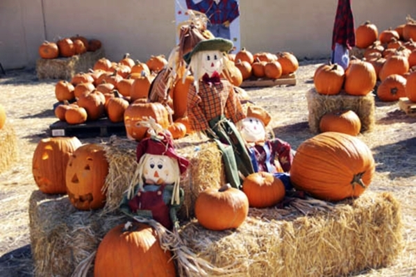 Pumpkins and scarecrows sit atop hay bales at the First Henderson United Methodist Church's annual Pumpkin Patch event in 2014. The event is planned again this year from Oct. 11-31 at the ch ...
