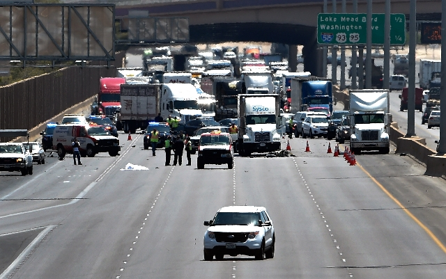 Las Vegas police investigate a fatal crash involving a motorcycle on northbound Interstate 15 just south of Cheyenne Avenue on Tuesday, June 23, 2015. (David Becker/Las Vegas Review-Journal)