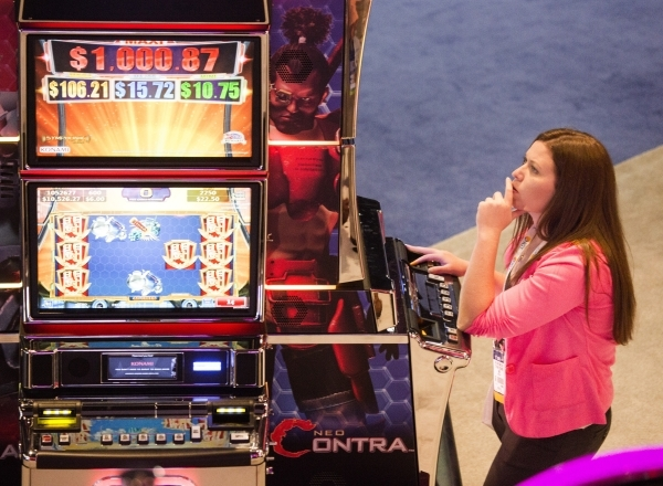 Stephanie Ostrander plays Neo Contra game by Konami during the Global Gaming Expo at the  Sands Expo and Convention Center on Tuesday, Sept. 29,2015. (Jeff Scheid/ Las Vegas Review-Journal Follow  ...