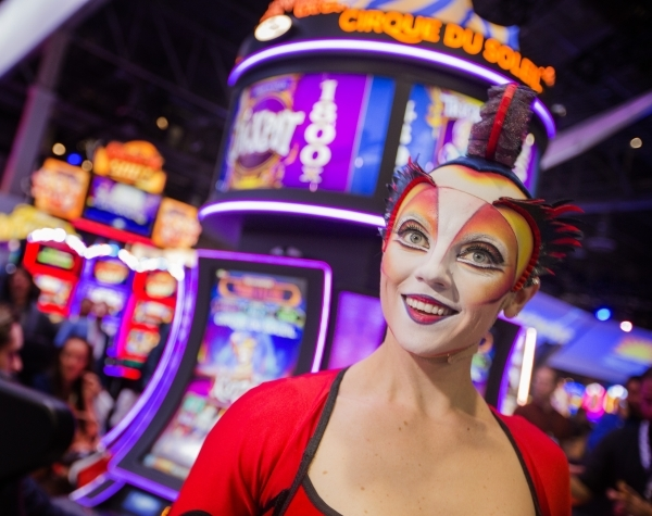A Cirque du Soleil performers stands in front of the newest Cirque du Soleil-themed slots at Scientific Games booth during the Global Gaming Expo at the  Sands Expo and Convention Center on Tuesda ...