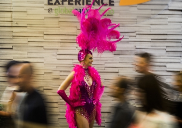 Showgirl Claudia Cervenka greets people during the Global Gaming Expo inside the Sands Expo and Convention Center on Tuesday, Sept. 29,2015. 2015. (Jeff Scheid/ Las Vegas Review-Journal Follow @jl ...