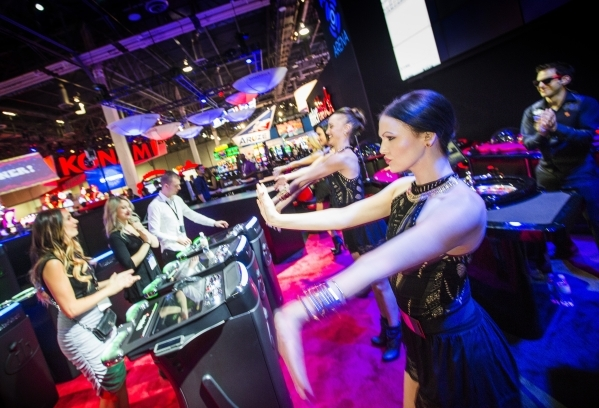 The Diamond Girls perform in the Interblock Gaming booth at the Global Gaming Expo in the Sands Expo and Convention Center on Wednesday, Sept. 30, 2015. (Jeff Scheid/ Las Vegas Review-Journal Foll ...