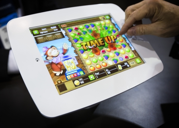 A bar-top tablet skill-based game is demonstrated at the Gamblit Gaming booth at the Global Gaming Expo in the Sands Expo and Convention Center on Wednesday, Sept. 30, 2015. (Jeff Scheid/ Las Vega ...
