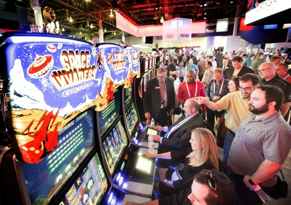 People play a Space Invaders skill-based gaming machine in the Scientific Games booth at the Global Gaming Expo in the Sands Expo and Convention Center on Wednesday, Sept. 30, 2015. (Jeff Scheid/  ...