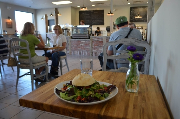 The EST (East) Sandwich at Rosallie Le French Cafe, 6090 S. Rainbow Blvd., is shown with Brie and tomato toasted with olive oil and garlic on a French bread roll. It is served on a bed of mixed gr ...