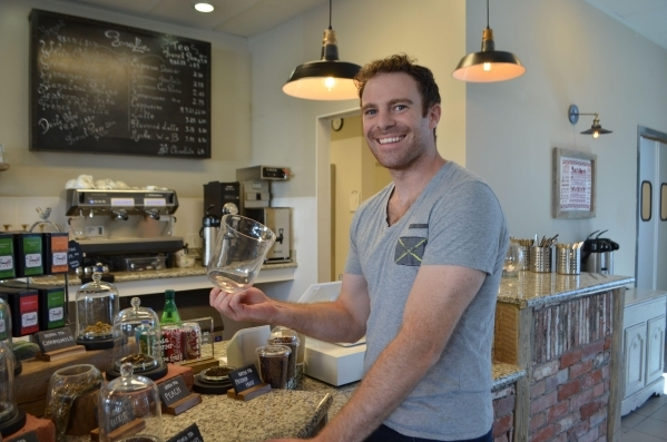 Jonathan Pluvinet samples the scent of tea leaves inside his new restaurant, Rosallie Le French Cafe, 6090 S. Rainbow Blvd. (Ginger Meurer/Special to View)