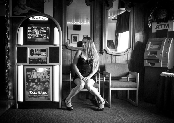Prostitute  Venus, 29, sits in the waiting room at the Wild Cat Ranch brothel near  Mina, Nevada on Thursday, Sept. 26, 2013. Phil Maita bought the and reopen the establishment in August. (Photo b ...