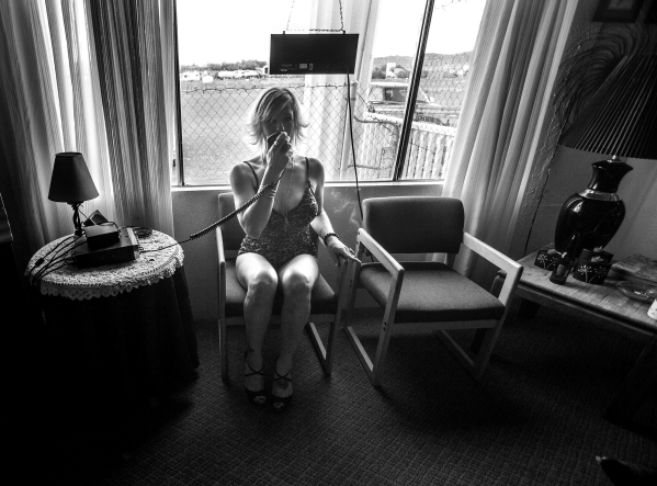 Prostitute Payton, 30  talks to a trucker on a citizen band radio at the  Wild Cat Ranch brothel near  Mina, Nevada on Thursday, Sept. 26, 2013. Phil Maita bought the and reopen the establishment  ...