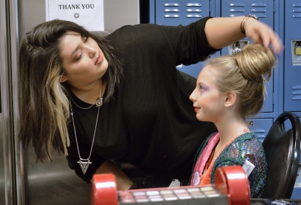 Makeup artist and hair stylist Nichole Champion, left, works on Brinkley Woodrow at the Opportunity Village Thrift Store at 390 S. Decatur Blvd. in Las Vegas on Sunday, Oct. 4, 2015. Bill Hughes/L ...